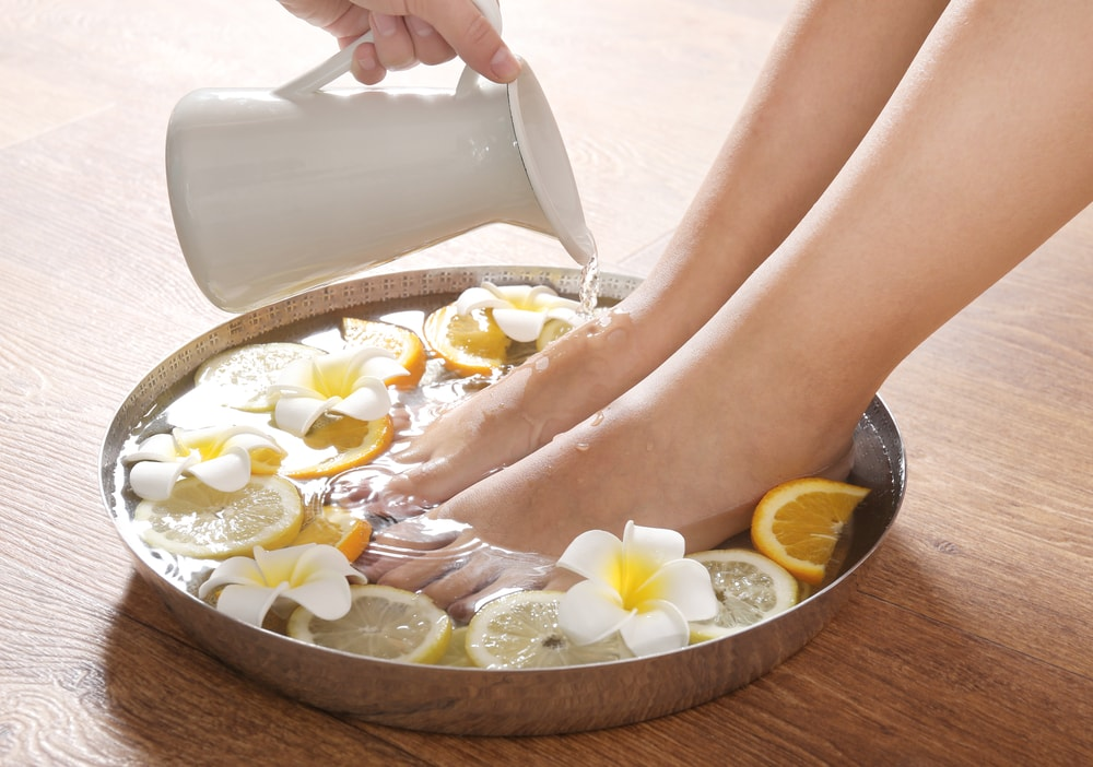 remove dead skin by soaking feet in lemon juice