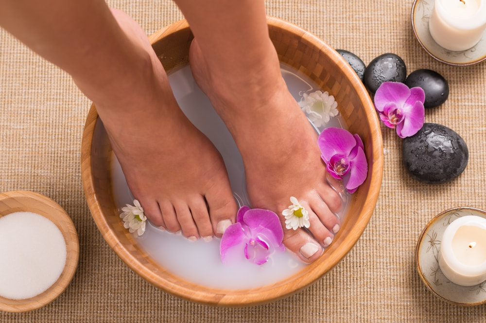use warm water and soap to help remove dead skin from feet
